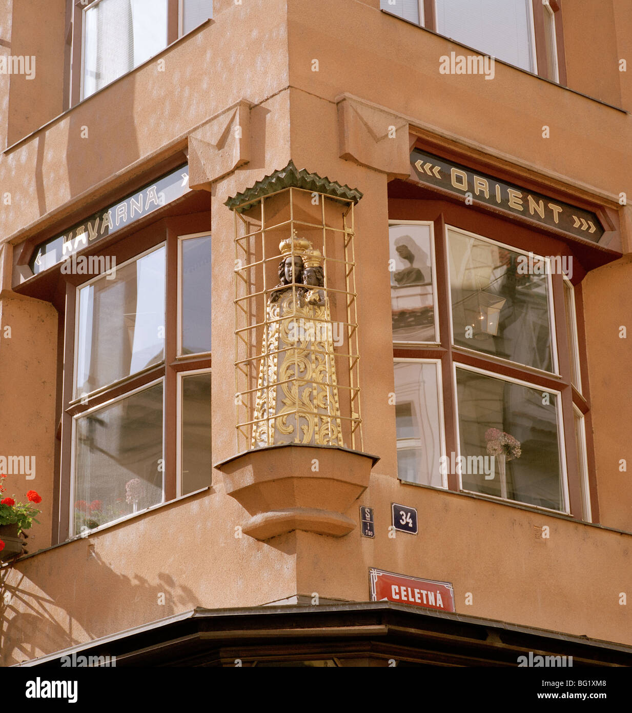 World Travel. Statue Of The Virgin On The House Of The