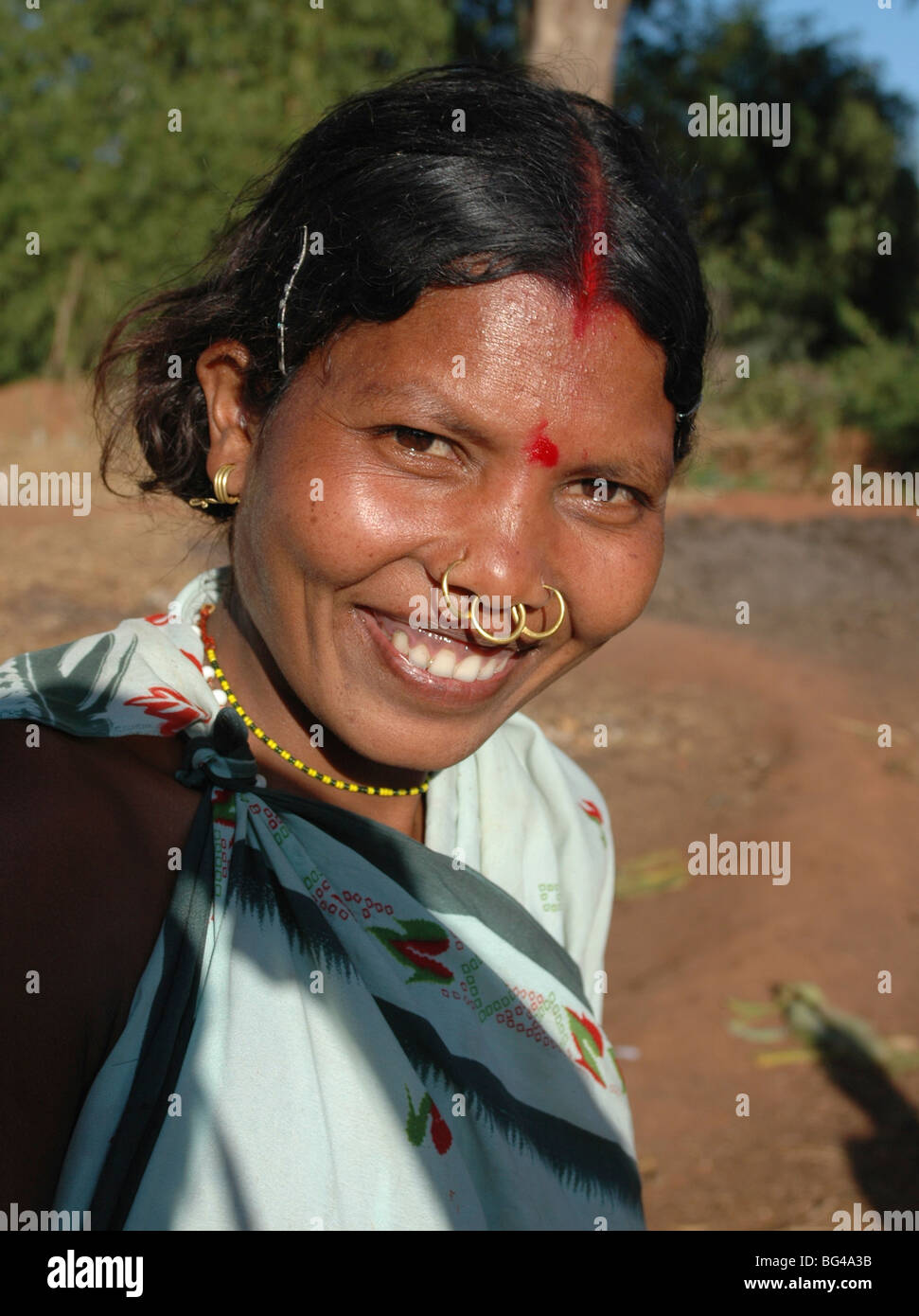Smiling Dongoria Kondh married woman, with tribal nose rings, Kuvi ...