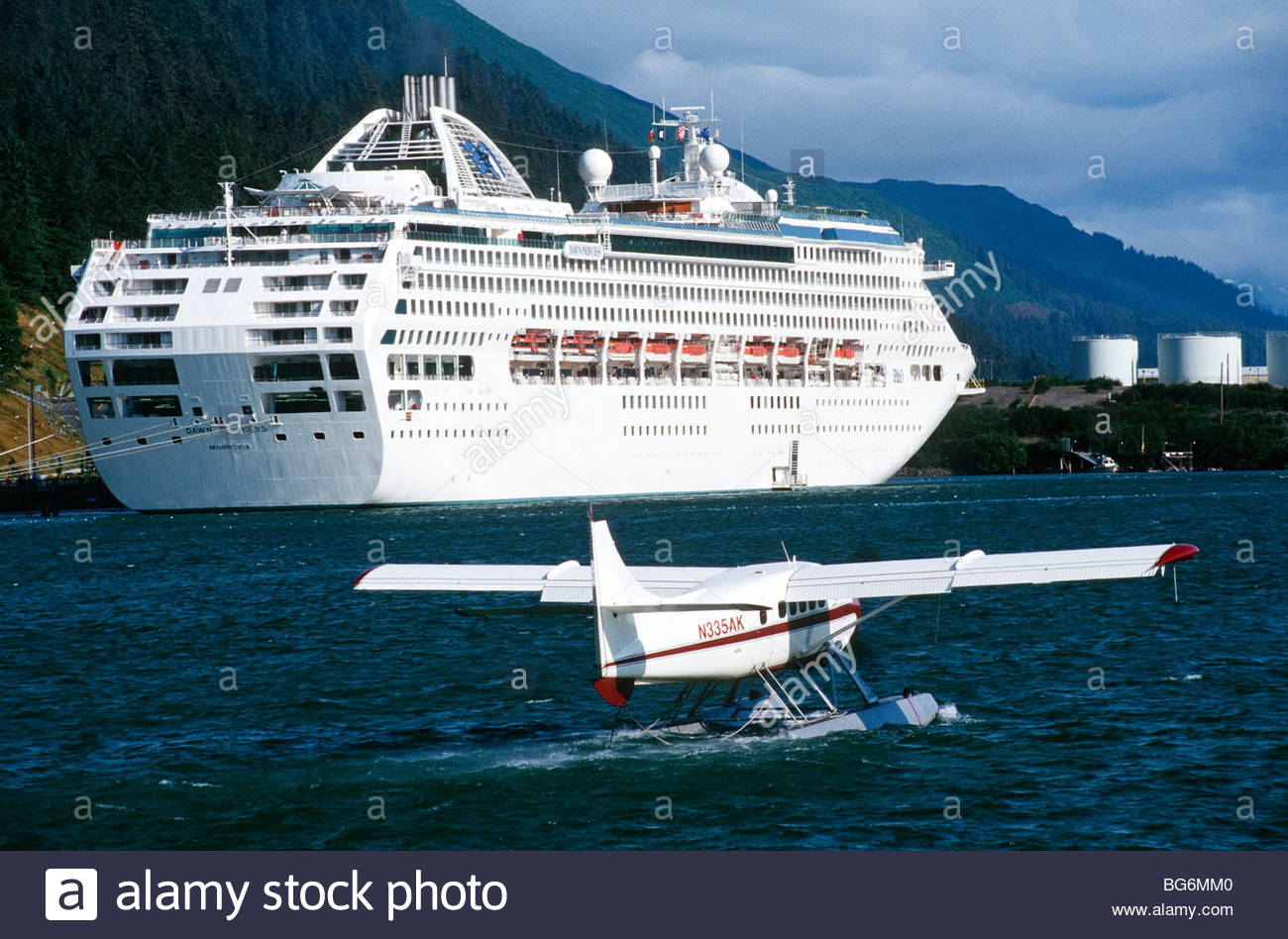 Alaska Juneau Cruise Ship At Dock With Float Plane Taking Off - How can cruise ships float