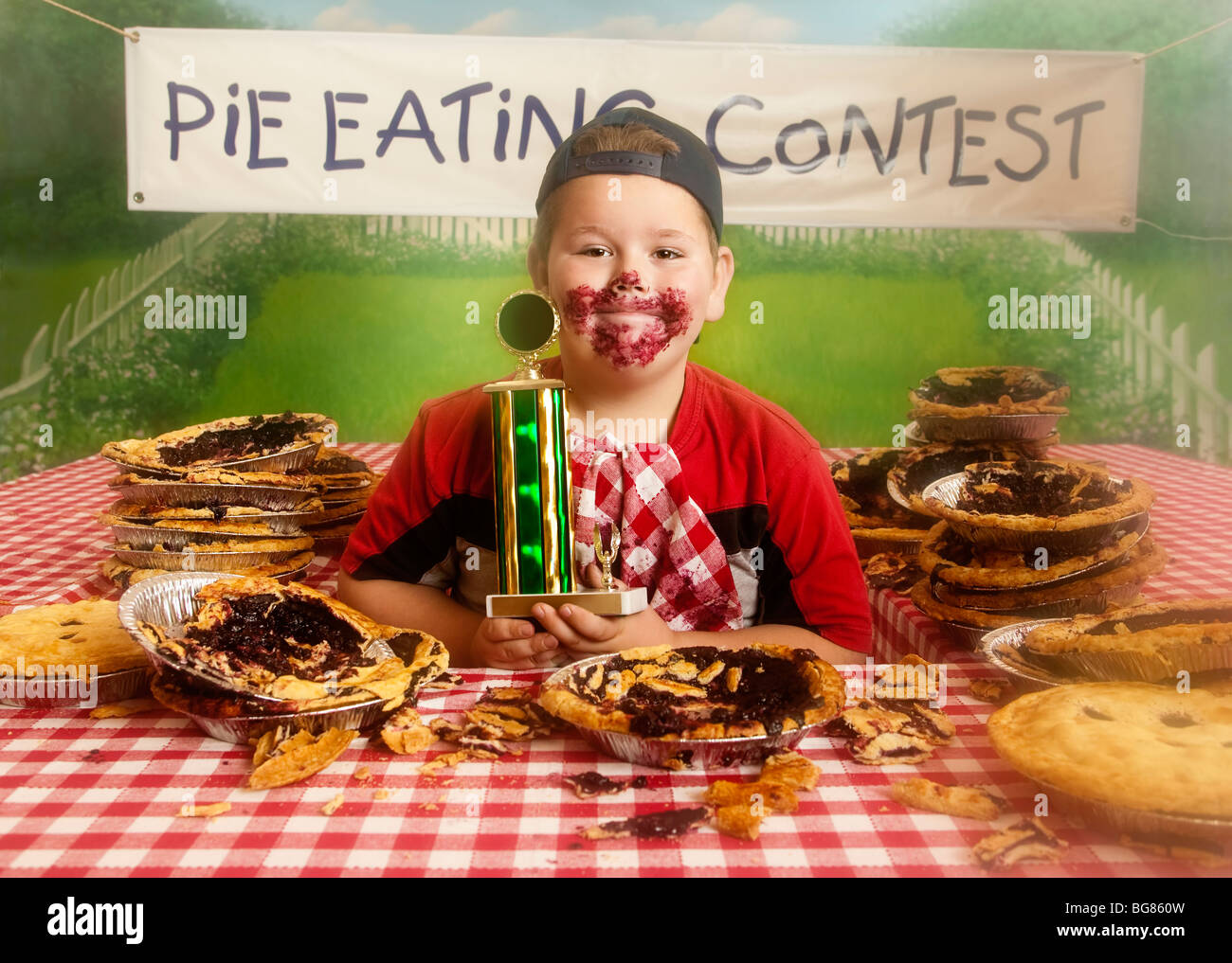 Boy at pie eating contest Stock Photo, Royalty Free Image ...