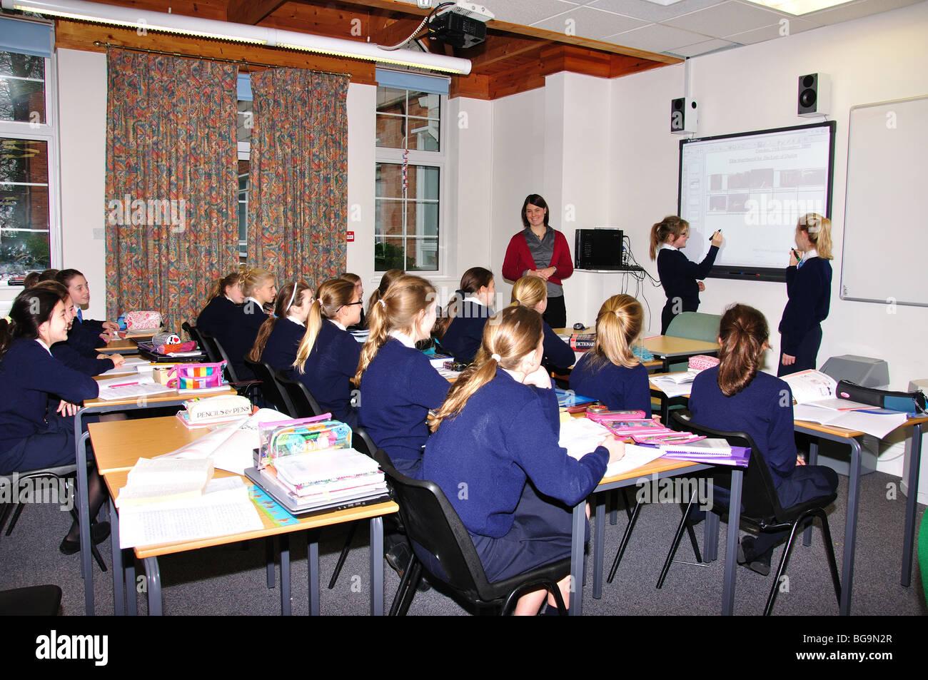 Female teacher teaching girls in classroom, Heathfield St.Mary's ...