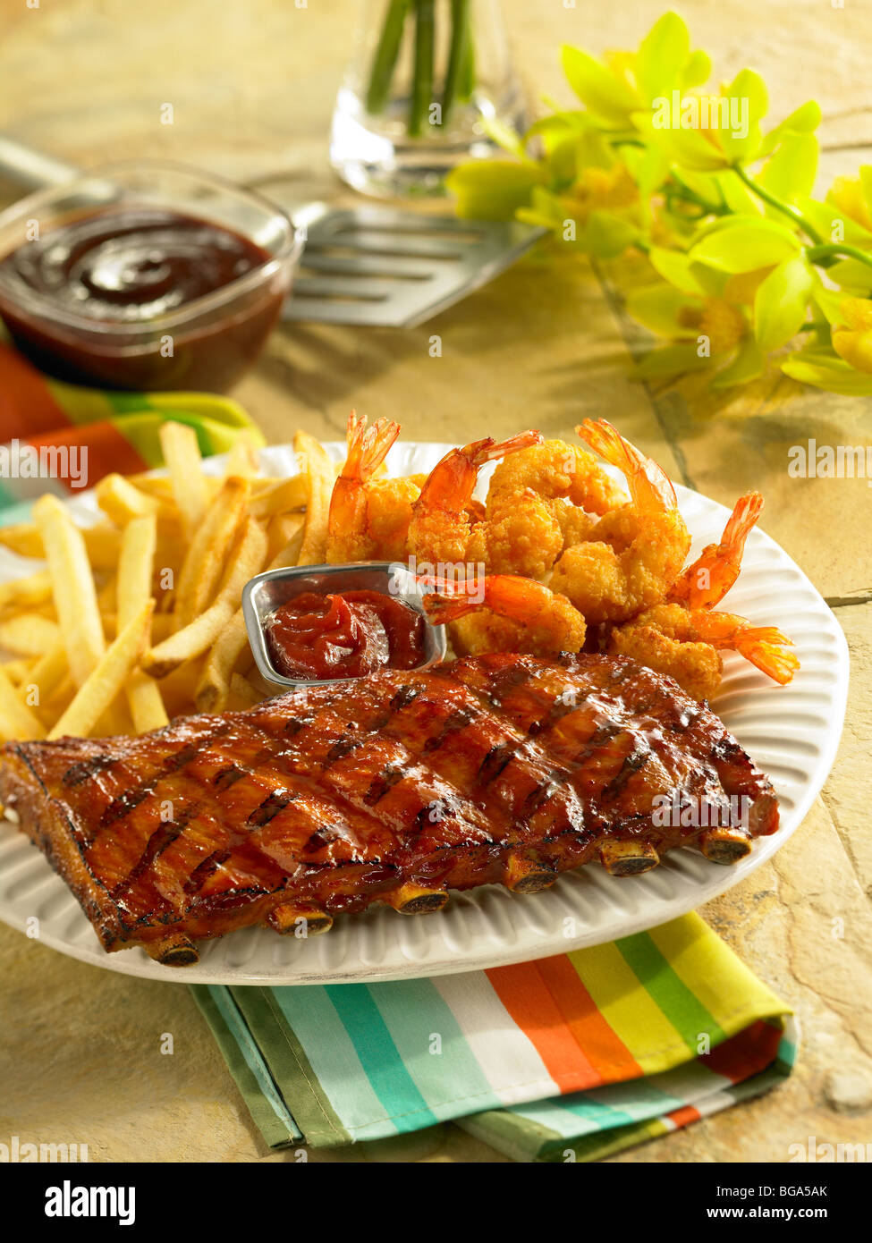 BBQ pork short ribs with fried shrimp and fried potatoes Stock ...