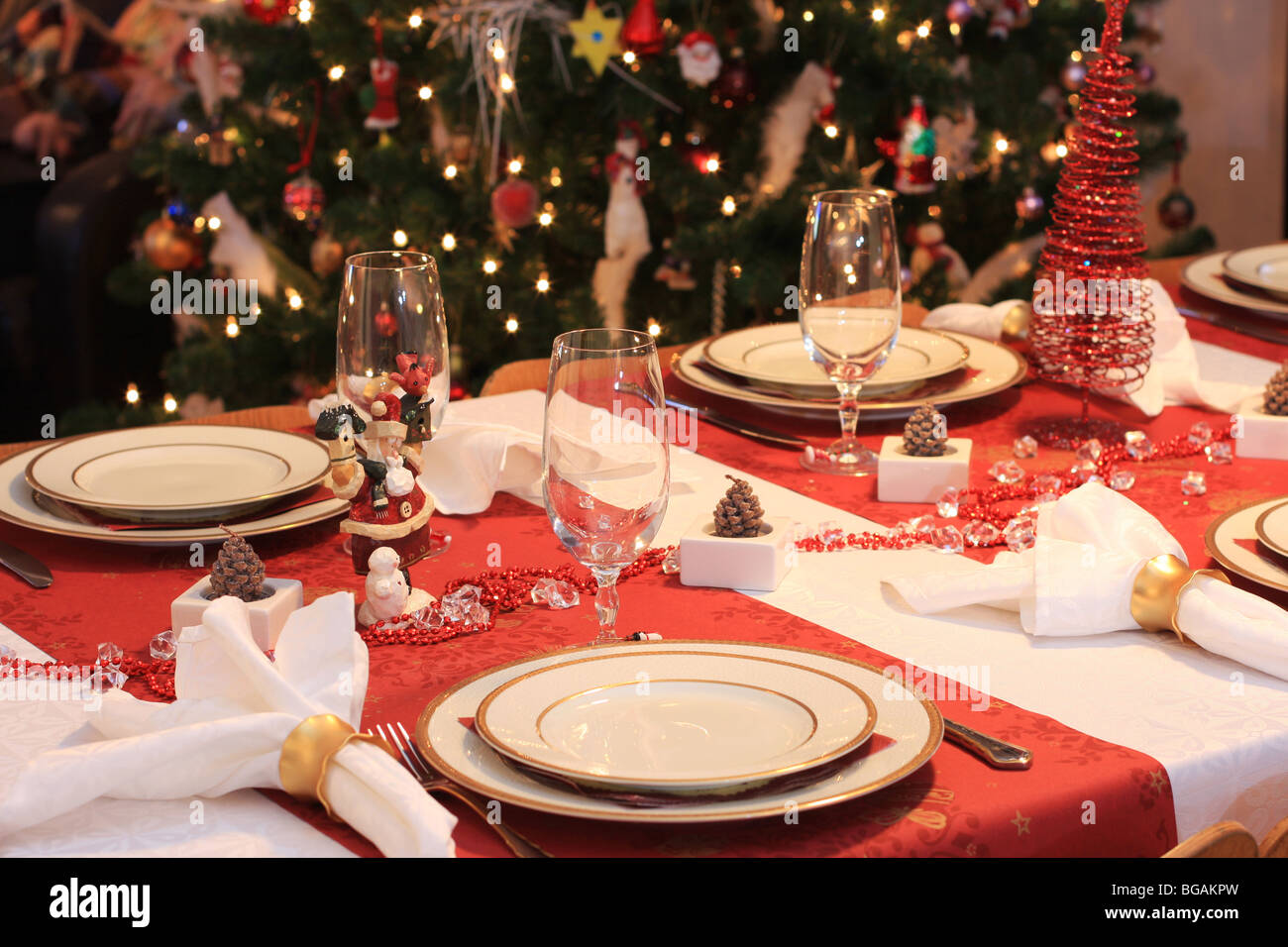 Dinner Table Background a set table for christmas night dinner, tree in background stock