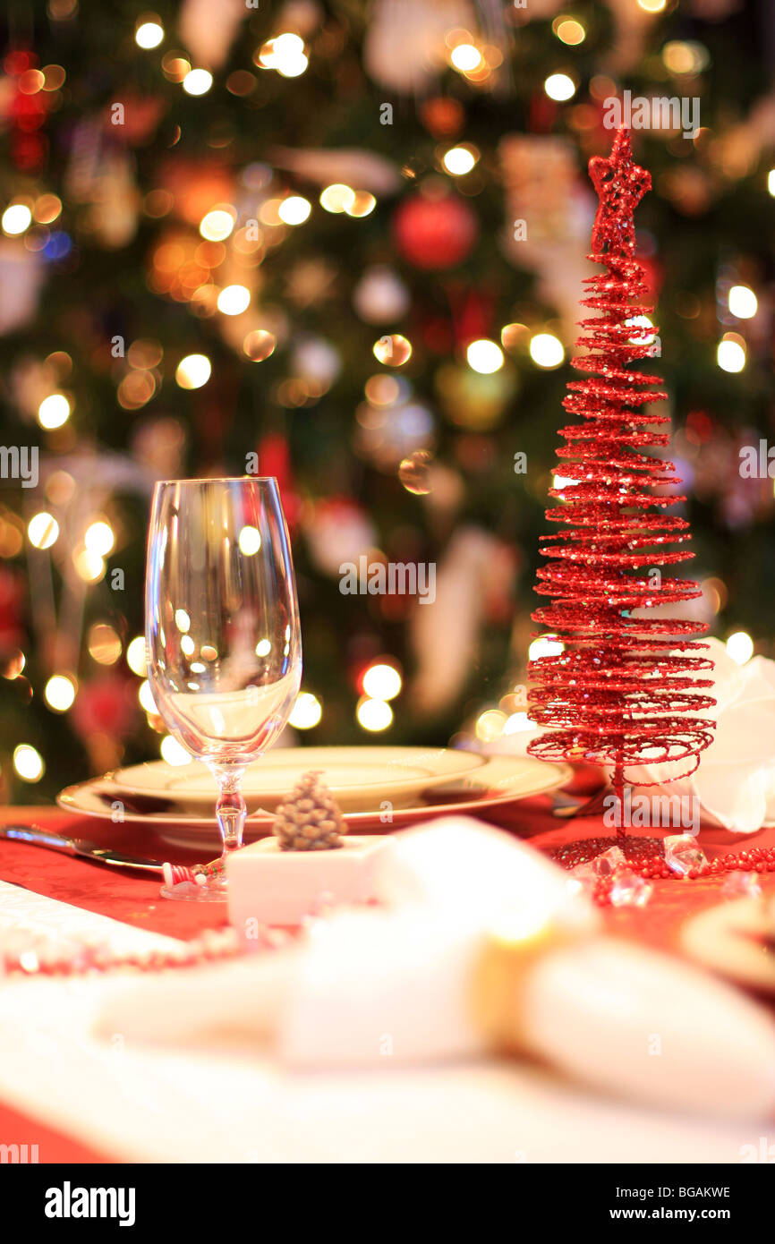 Dinner Table Background christmas dinner table set with decorated christmas tree in stock