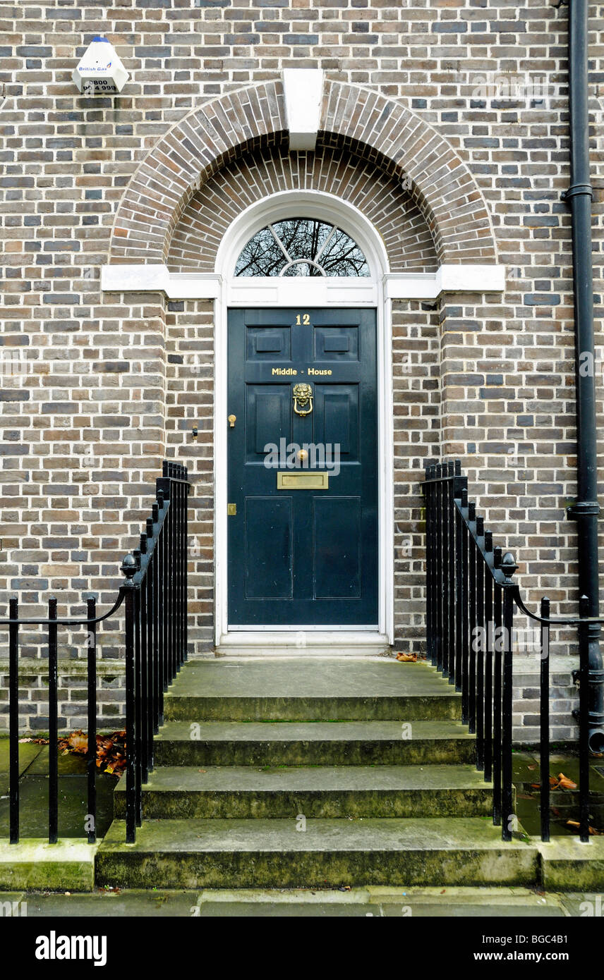 Black front door and steps to neo Georgian house Highbury Place Islington  London England UK -