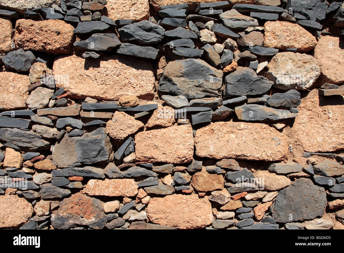 Various Types Of Volcanic Stone Used In The Building Of An Exterior Stock Photo Royalty Free