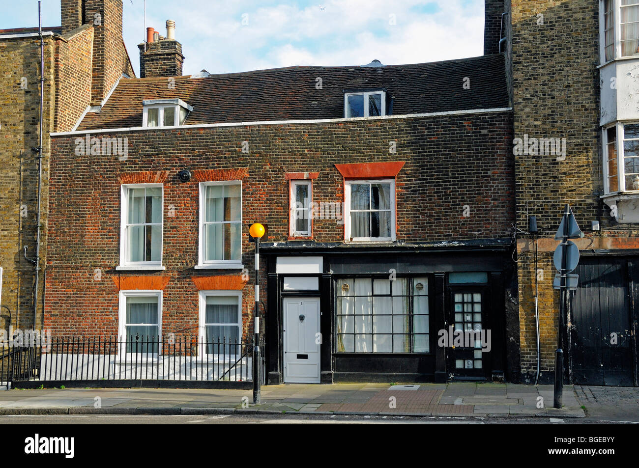 House with old shop front highgate village london england for British house store