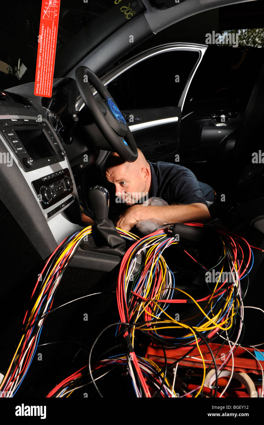 skoda octavia police car in warsaw stock photo royalty an electrician fitting out a wiring loom in a 2009 skoda octavia police car stock