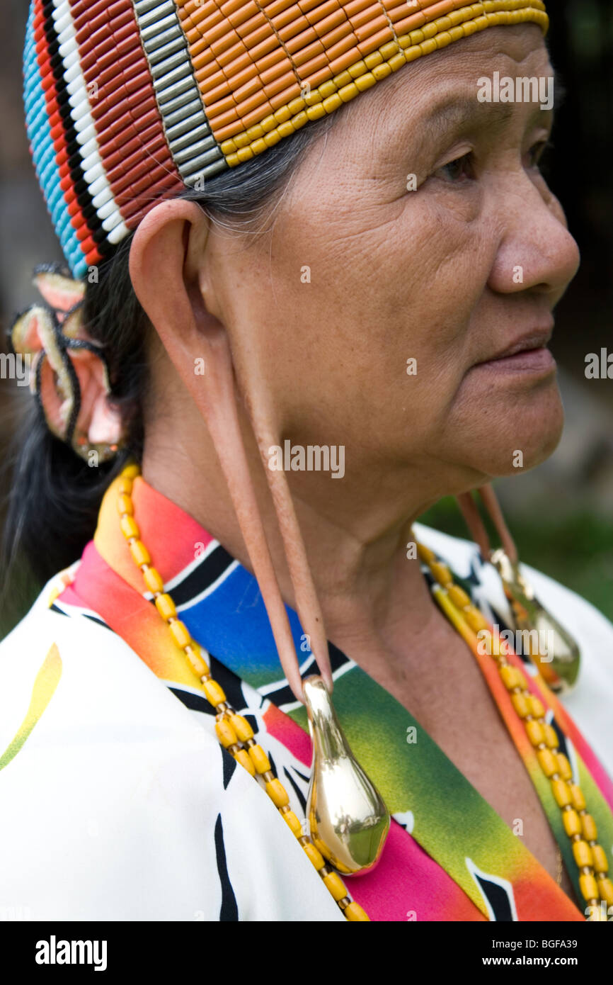 Kelabit Women With The Traditional Colourful Cap And Elongated Earlobes  With Bulky And Heavy Gold Earrings