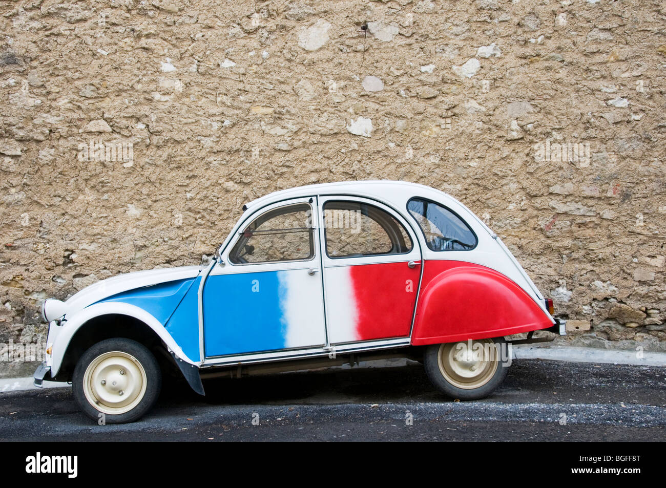 a citroen 2cv deux chevaux painted in the colours of the french stock photo royalty free. Black Bedroom Furniture Sets. Home Design Ideas