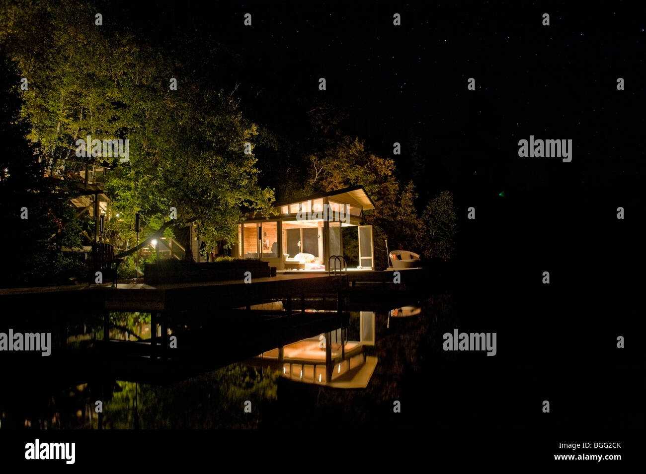 Cottage Lit Up At Night Lake Of The Woods Ontario Canada