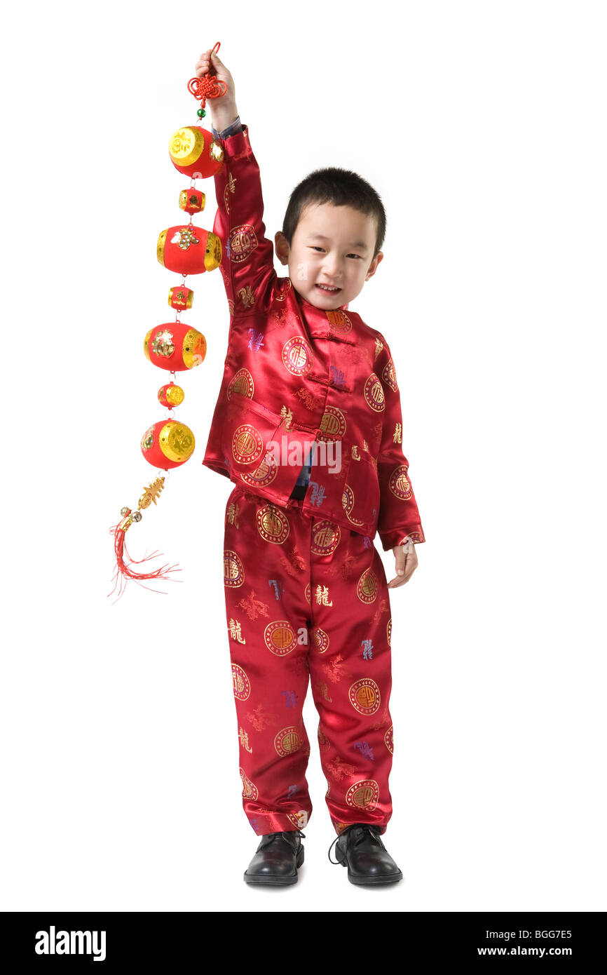 boy in chinese traditional clothes holding chinese new year stock photo royalty free image. Black Bedroom Furniture Sets. Home Design Ideas