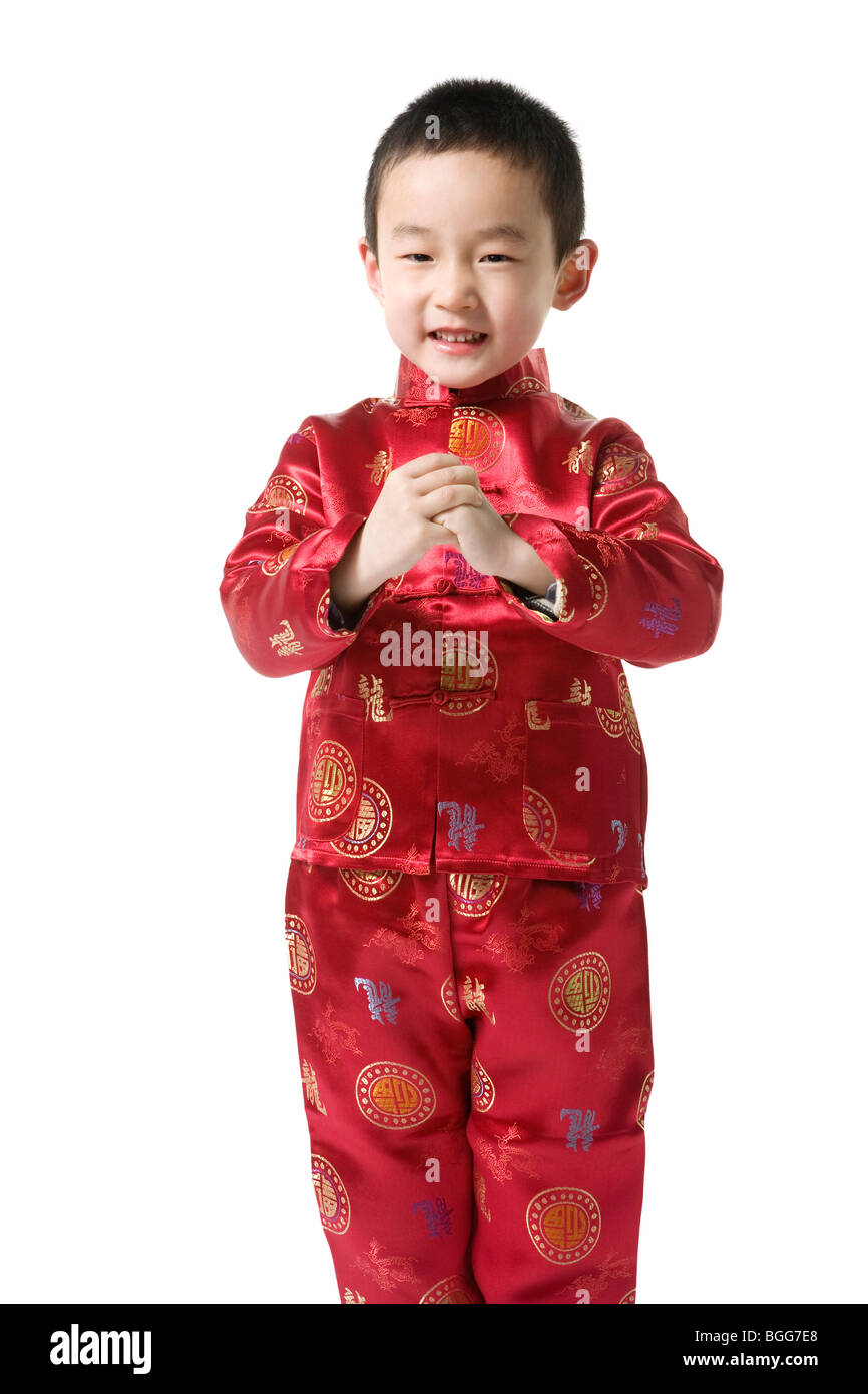 boy in chinese traditional clothes doing chinese new year greeting stock photo royalty free. Black Bedroom Furniture Sets. Home Design Ideas