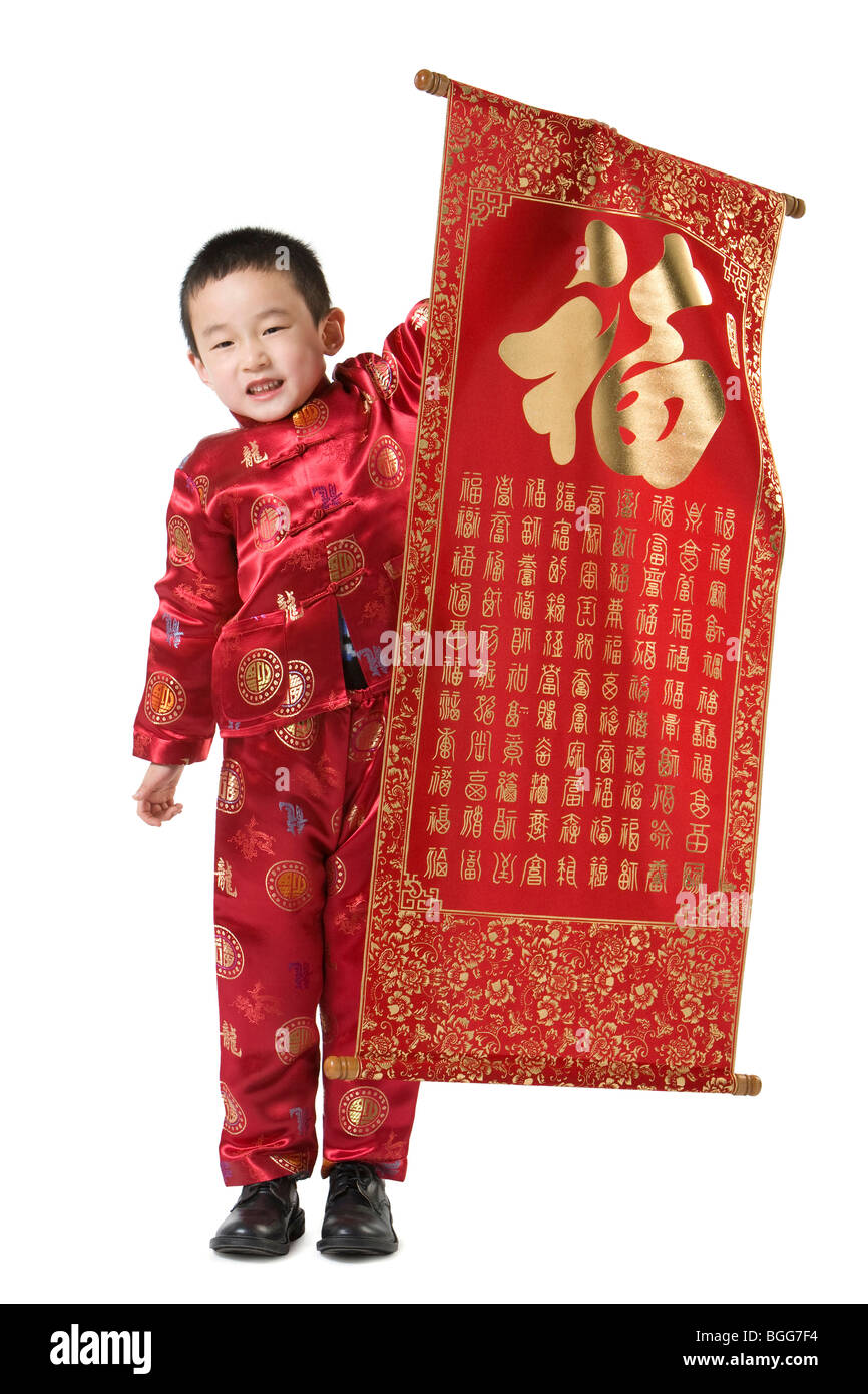 boy in chinese traditional clothes holding chinese new year scroll stock photo royalty free. Black Bedroom Furniture Sets. Home Design Ideas