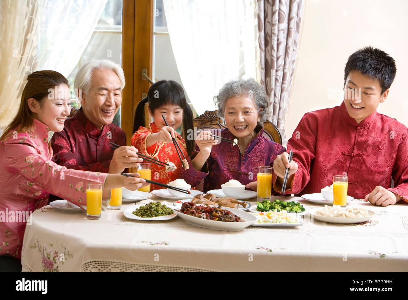 family having chinese new year dinner - Chinese New Year Dinner