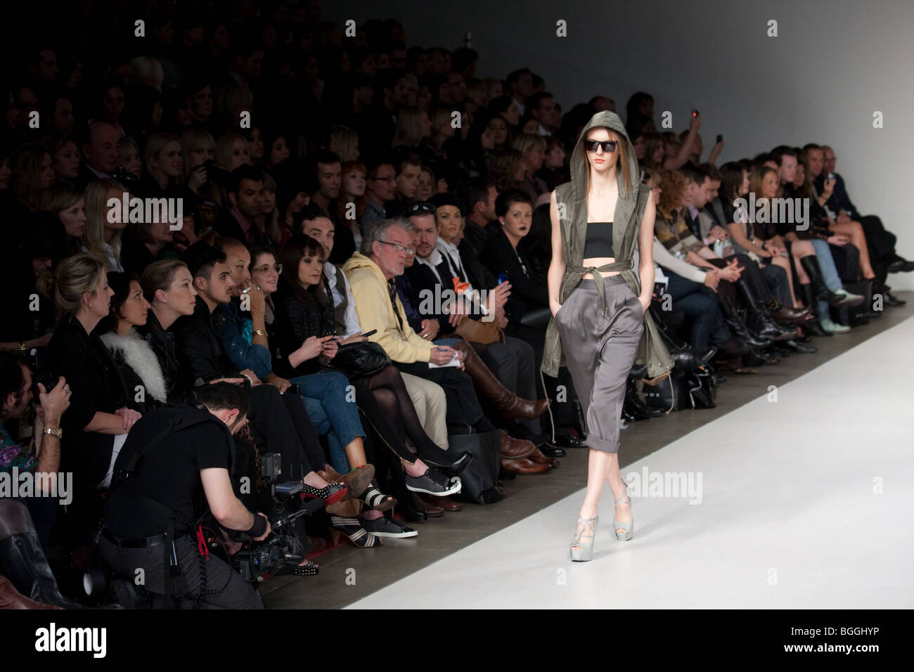 Fashion Show Runway Audience Female model wearing f...