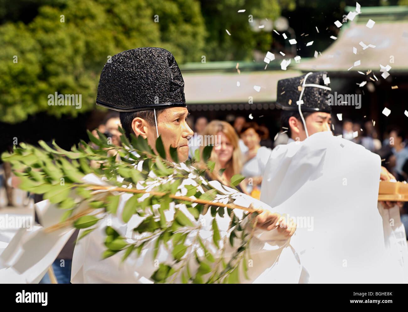 Japanese wedding blessings - Japanese Priest Waving Juniper Branch In Blessing Ceremony Meiji Shrine Japan