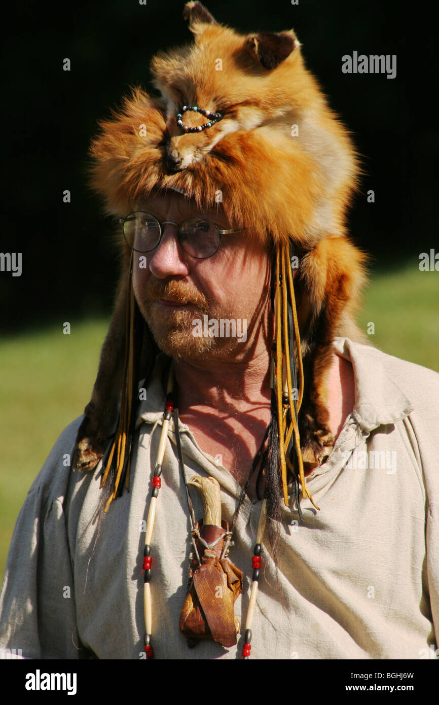 Fox with a hat new year or christmas animal isolated on white - Mountain Man With Red Fox Animal Hat Stock Image