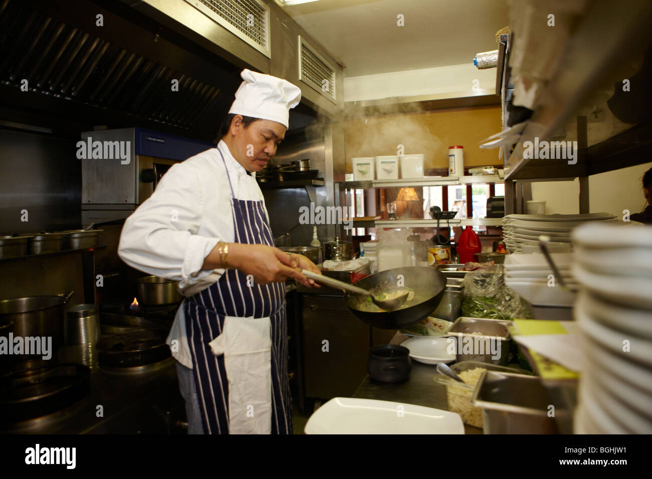 Asian chef cooking in restaurant kitchen stock photo for Kitchen 8 restaurant