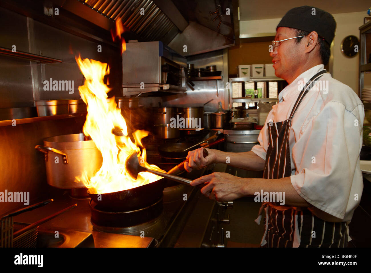Restaurant Kitchen Chefs asian chef cooking in restaurant kitchen stock photo, royalty free