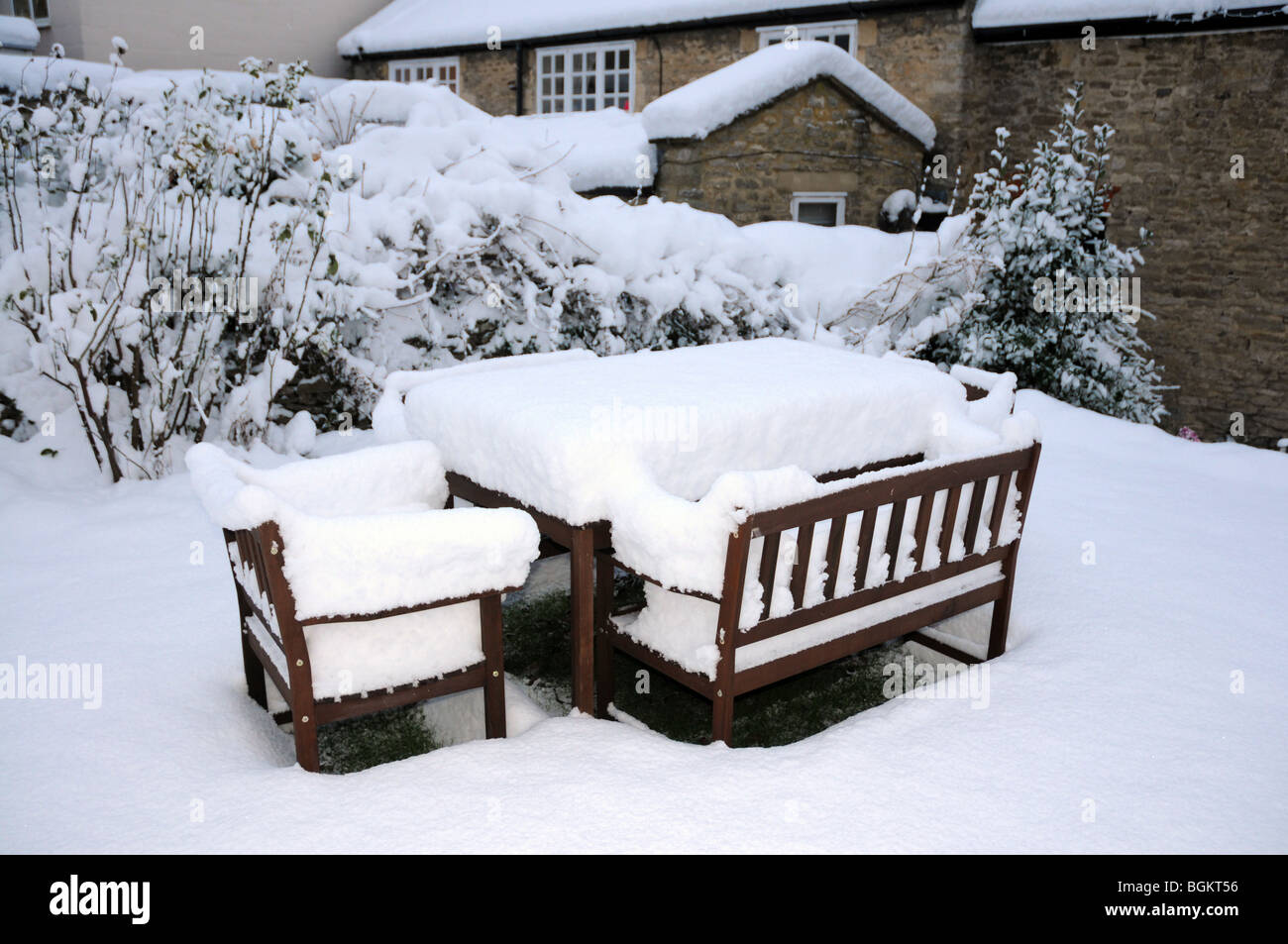 GArden furniture after a snowstorm in the cotswolds. GArden furniture after a snowstorm in the cotswolds Stock Photo