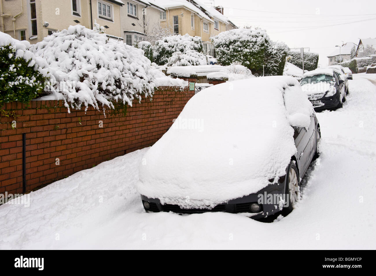 cars and road covered in snow at newport south wales uk. Black Bedroom Furniture Sets. Home Design Ideas