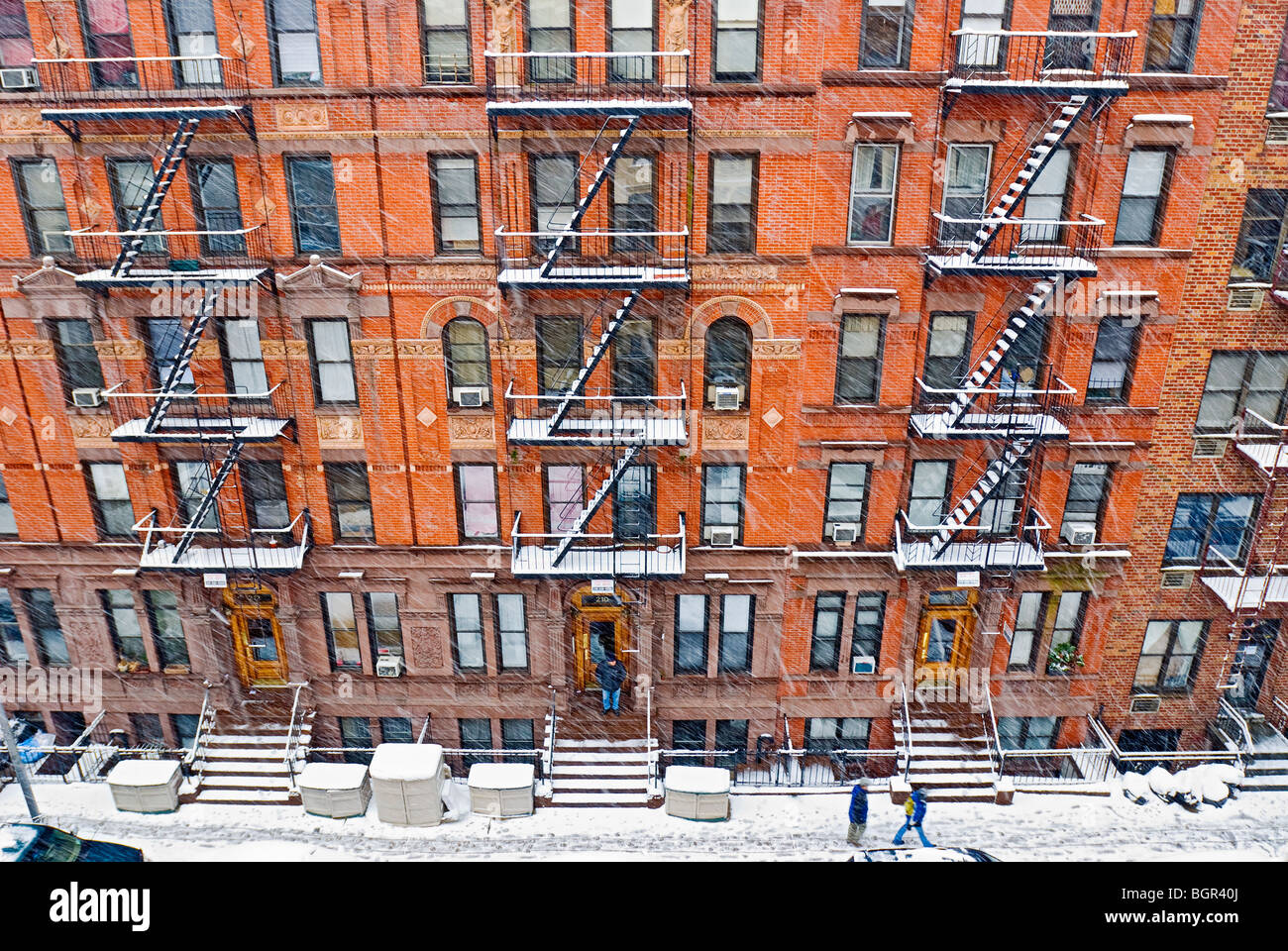 Tenement Apartment Buildings In New York City During Winter Snowstorm