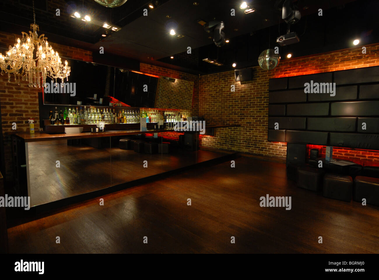 Modern bar. A stylish bar with contemporary decor and a wooden Stock ...