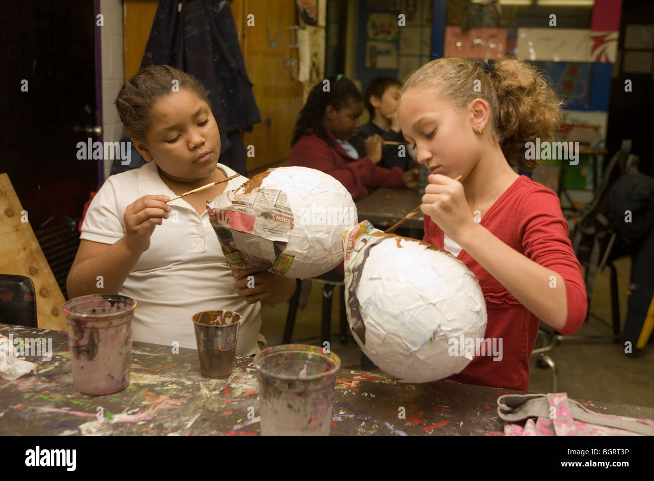 manhattan project stock photos manhattan project stock images girls work on paper mache art project at an after school community center in manhattan