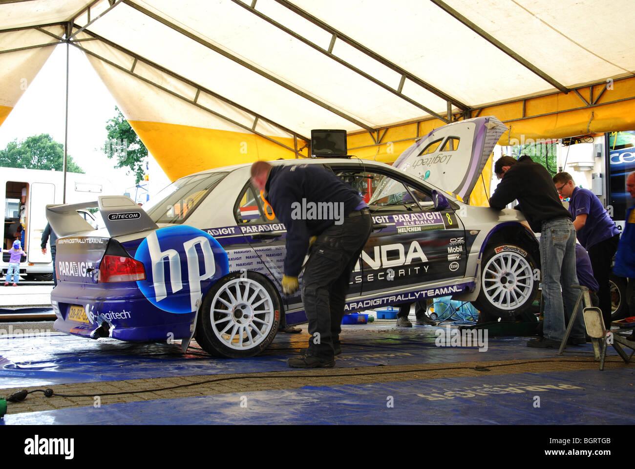tightening wheel nuts of Mitsubishi Lancer EVO 7 A8 rally car at ...