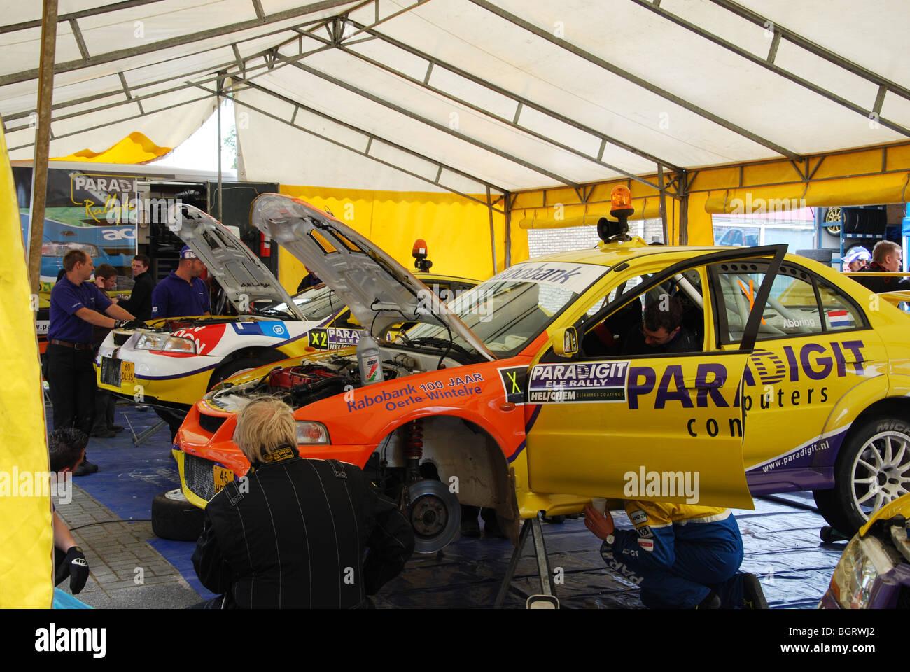 Mitsubishi Lancer EVO rally cars in service area at 2009 Stock ...