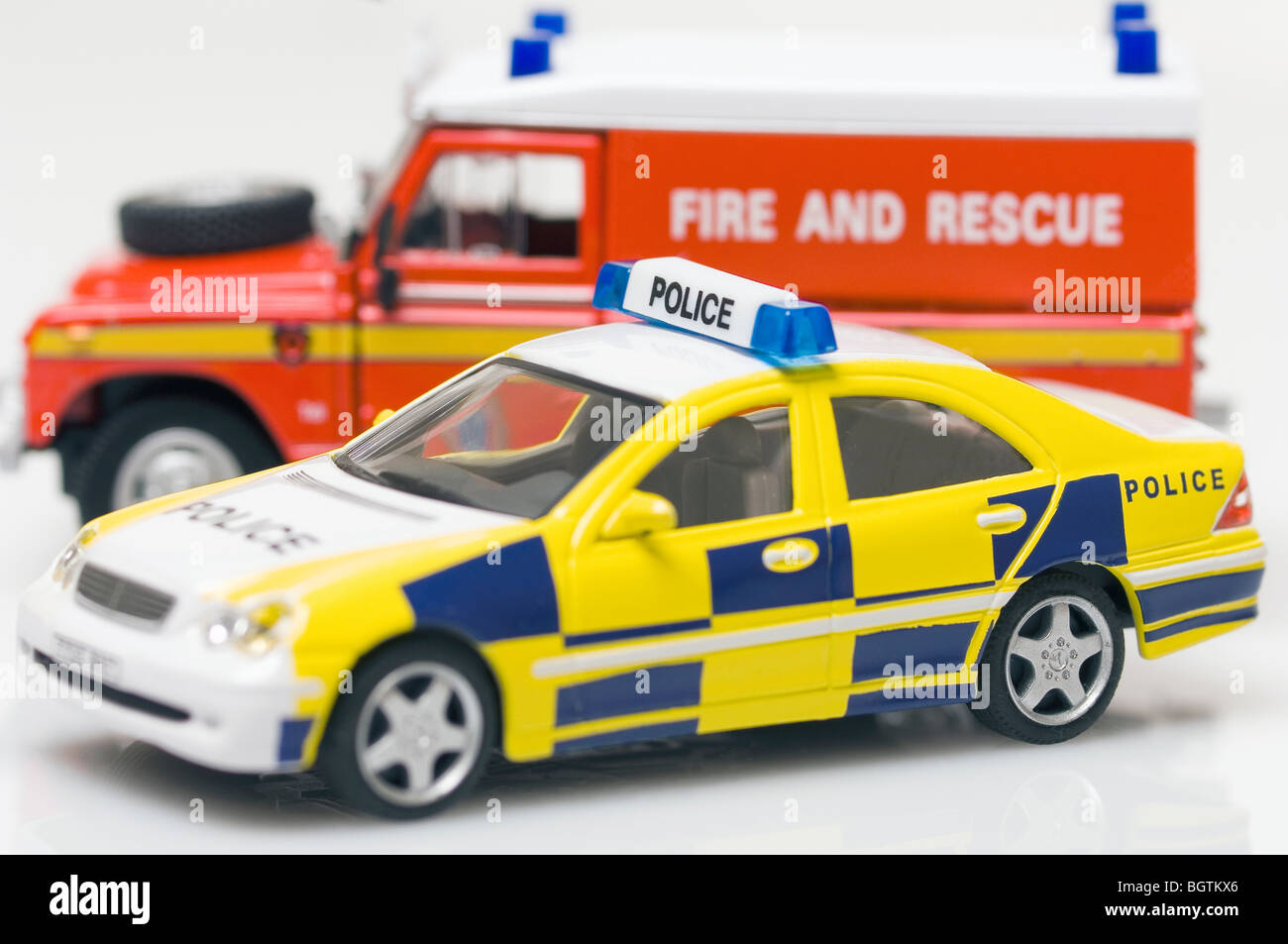 childrens toy police car and fire and rescue vehicle stock photo