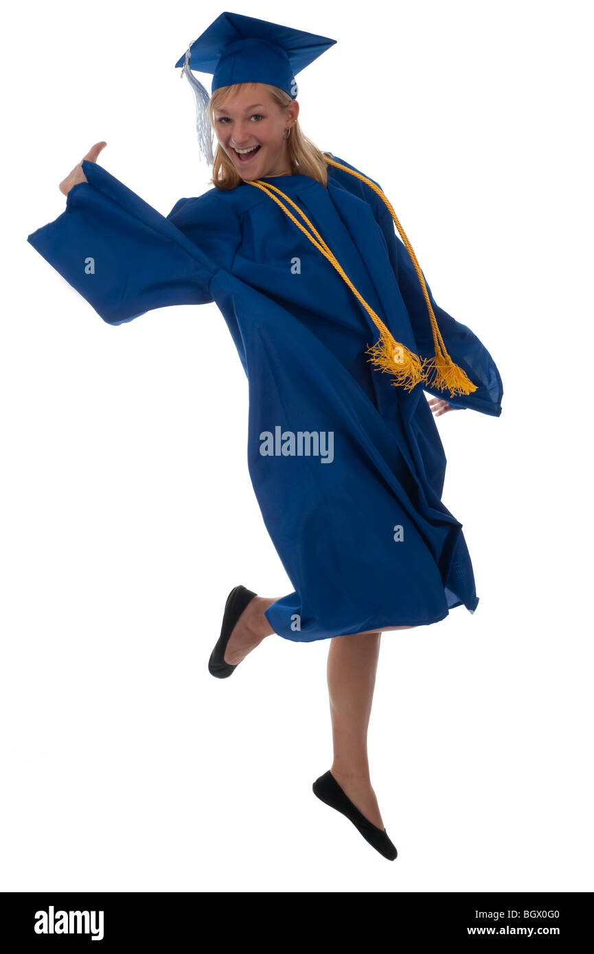 Teen girl in a graduation gown jumping for joy Stock Photo ...