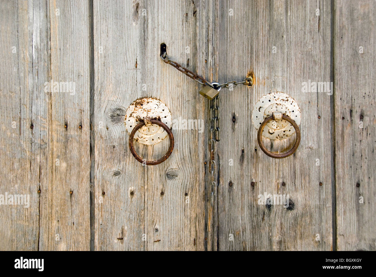 Old wooden doors with antique door furniture - Old Wooden Doors With Antique Door Furniture Stock Photo, Royalty