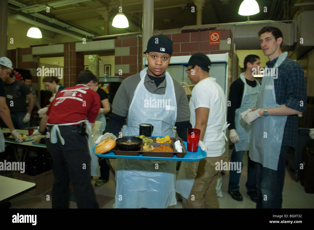 volunteers serve sunday lunch at the st. francis xavier mission's