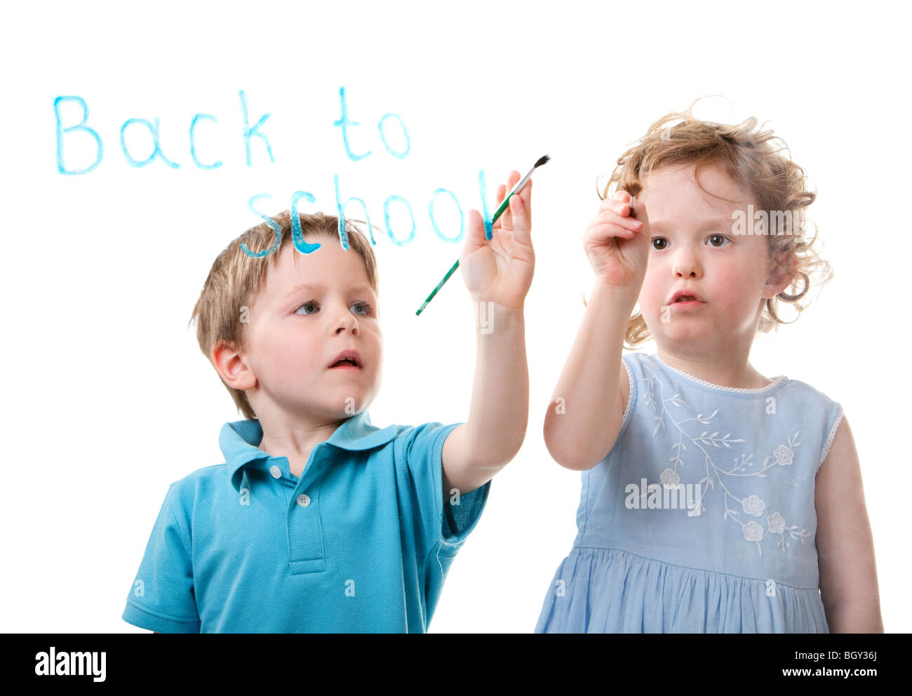 Back to school. Two small kids drawing on glass Stock Photo ...