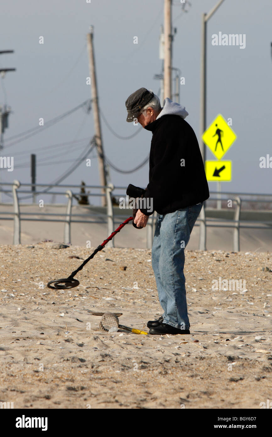 Jew Detector: An Old Man With A Metal Detector On The Beach On A Gray