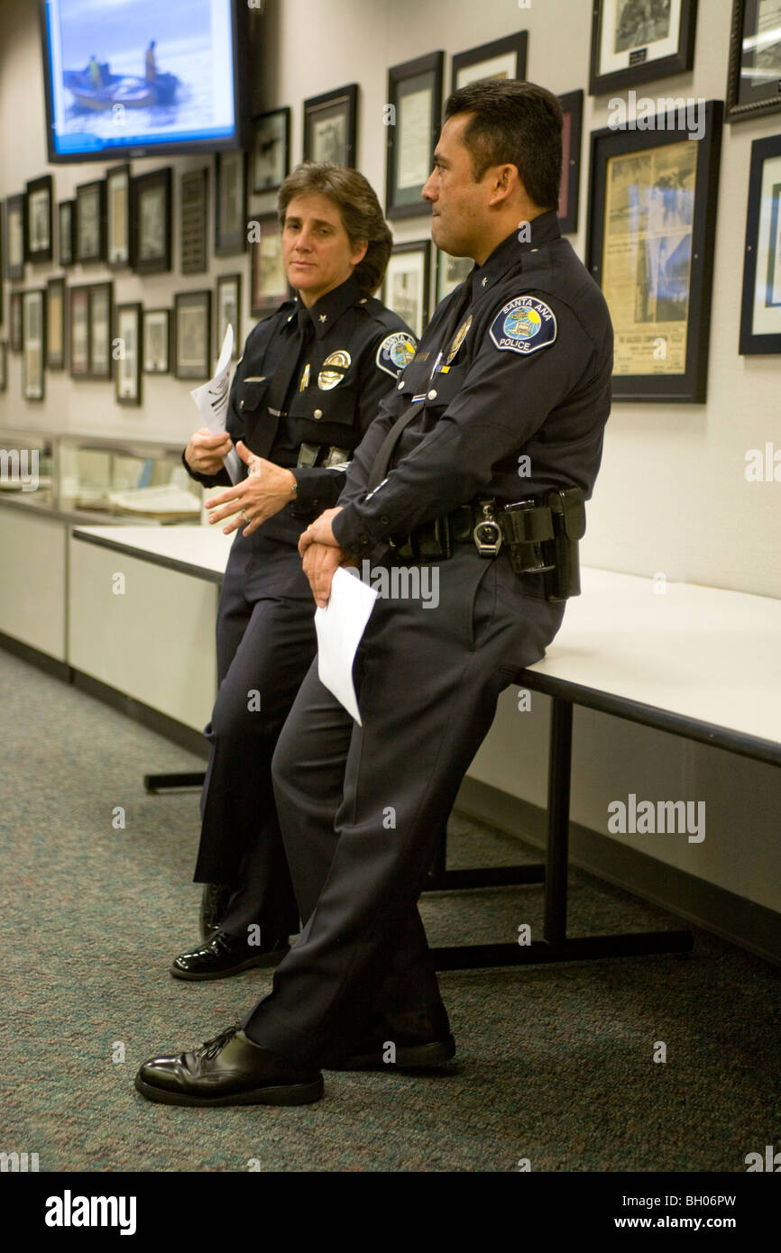 Female and male police officers of commander rank converse at stock photo royalty free image - Police officer in california ...