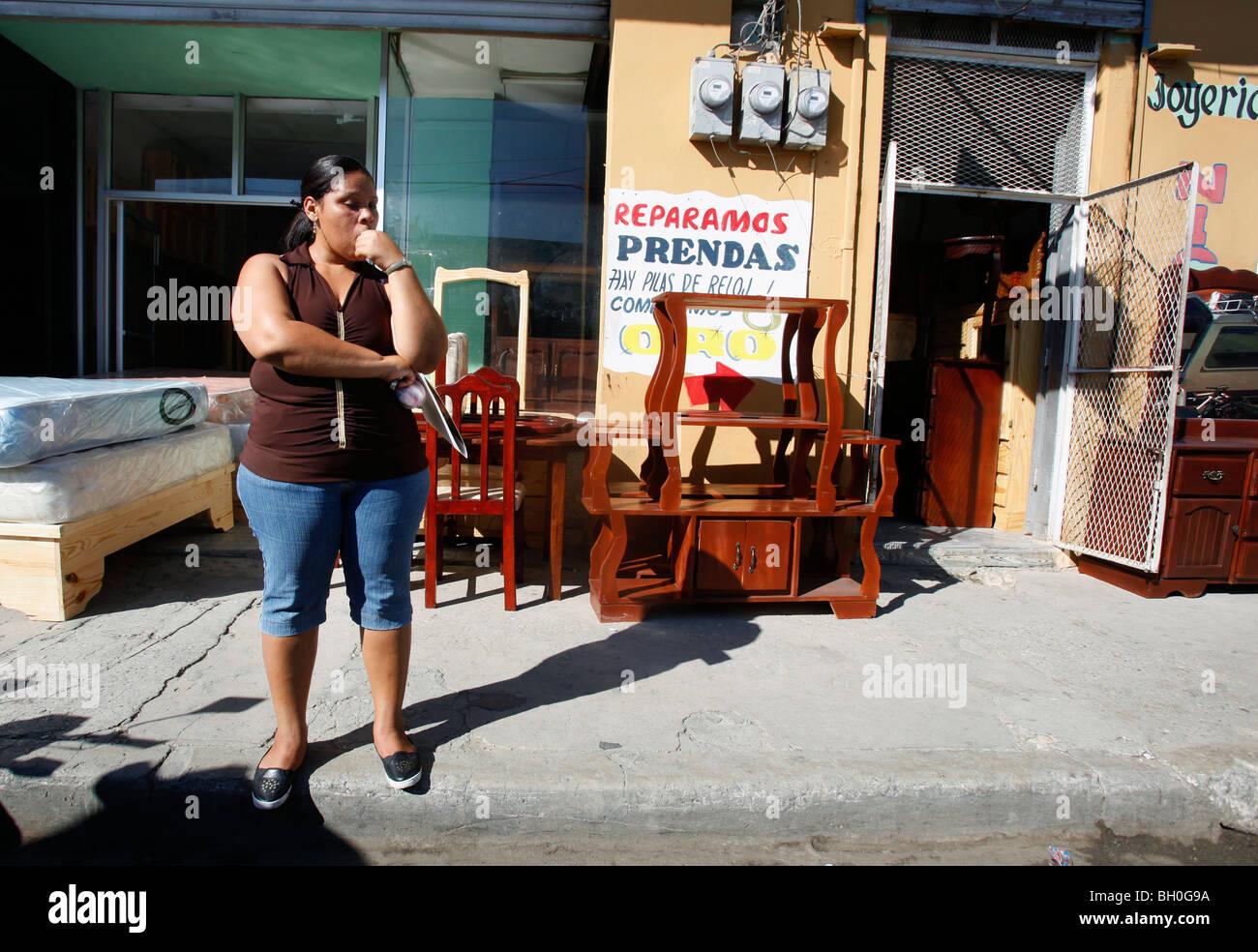 Woman Outside A Furniture Store, Barahona, Dominican Republic