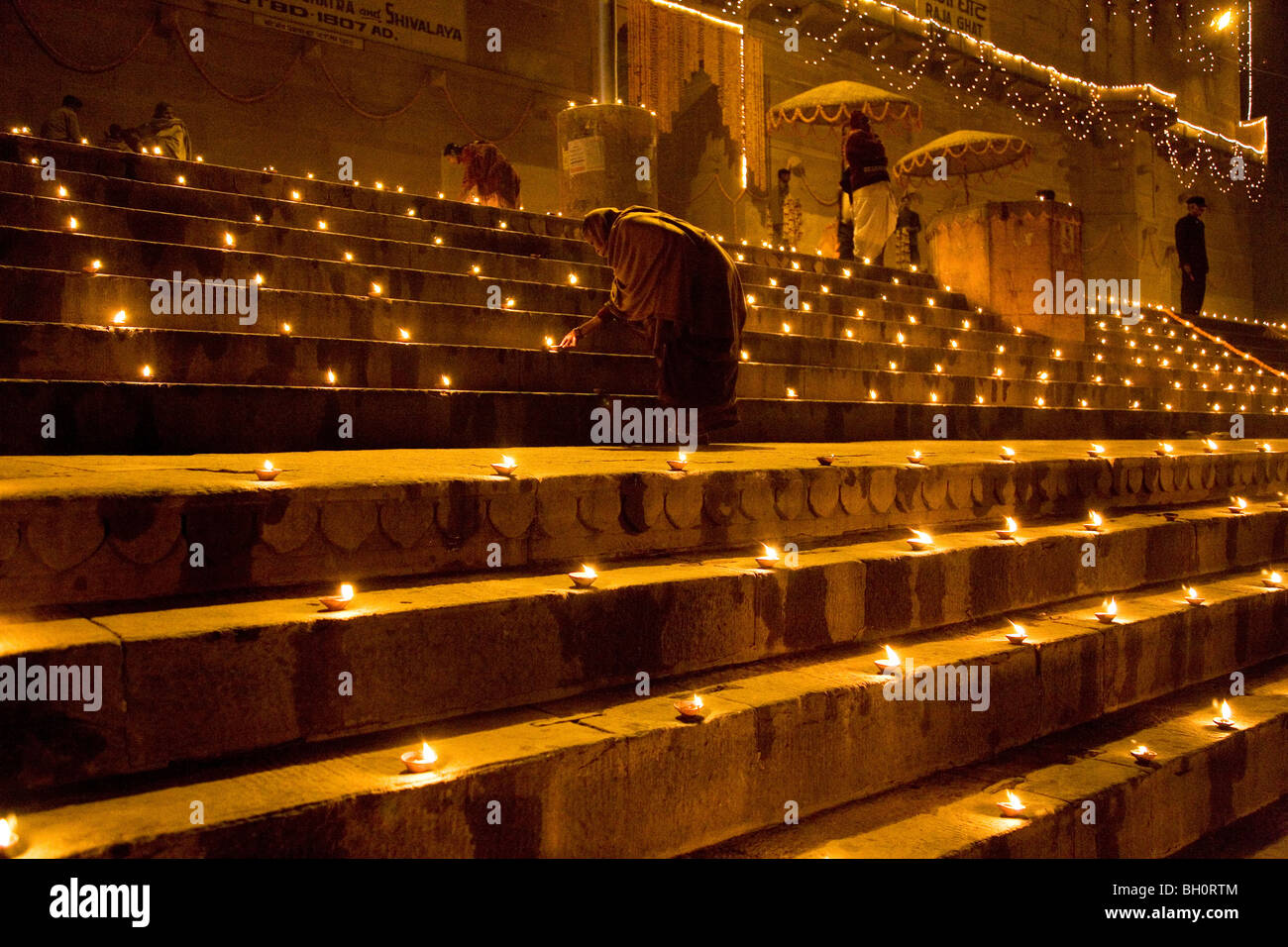 Night lamps india - A Priest Lights Lamps On The Steps Of The Ram Ghat In Varanasi India This Ritual Is Part Of The Ganga Aarthi
