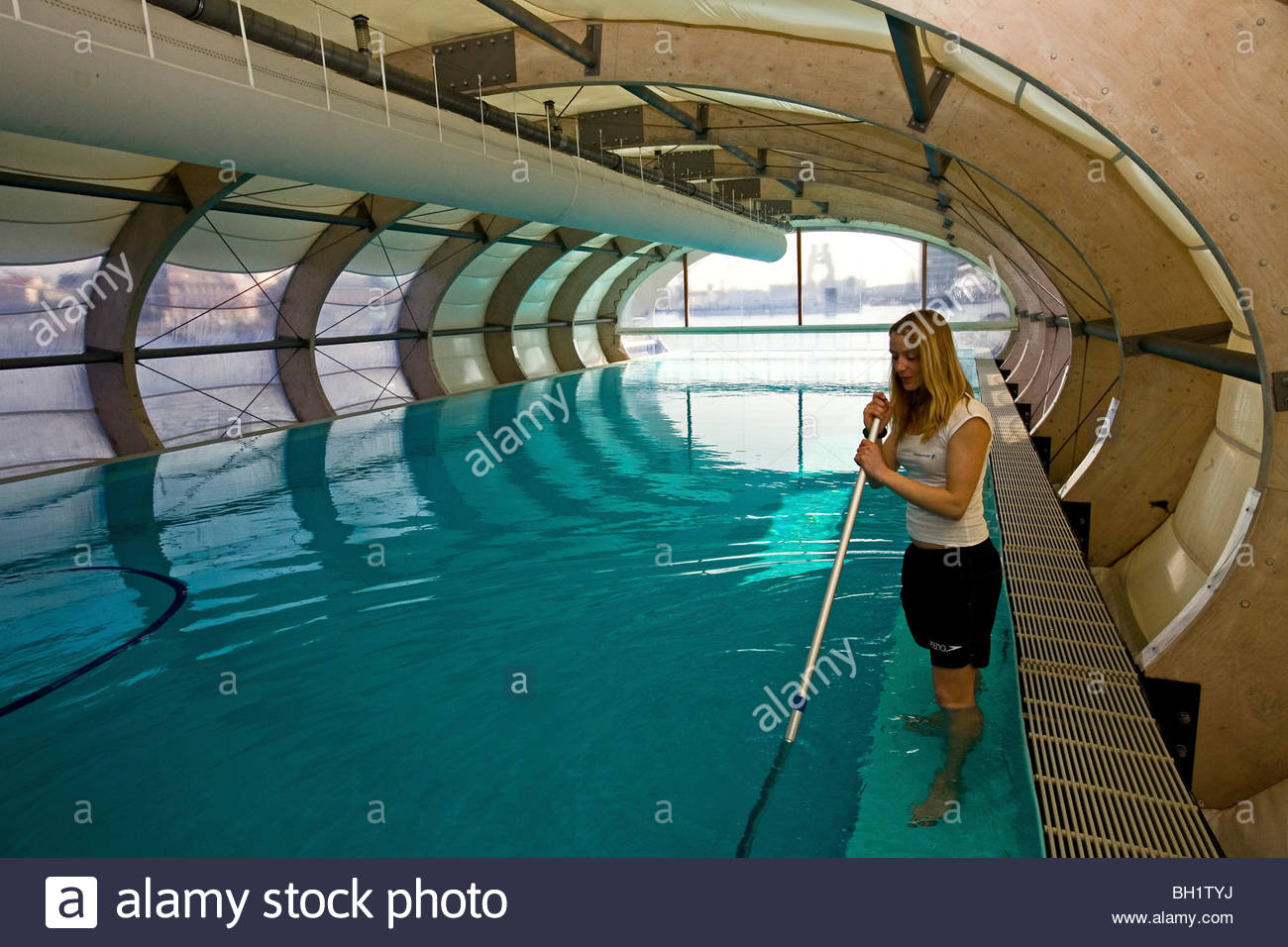 badeschiff cleaning the floating swimming pool berlin stock photo royalty free image. Black Bedroom Furniture Sets. Home Design Ideas