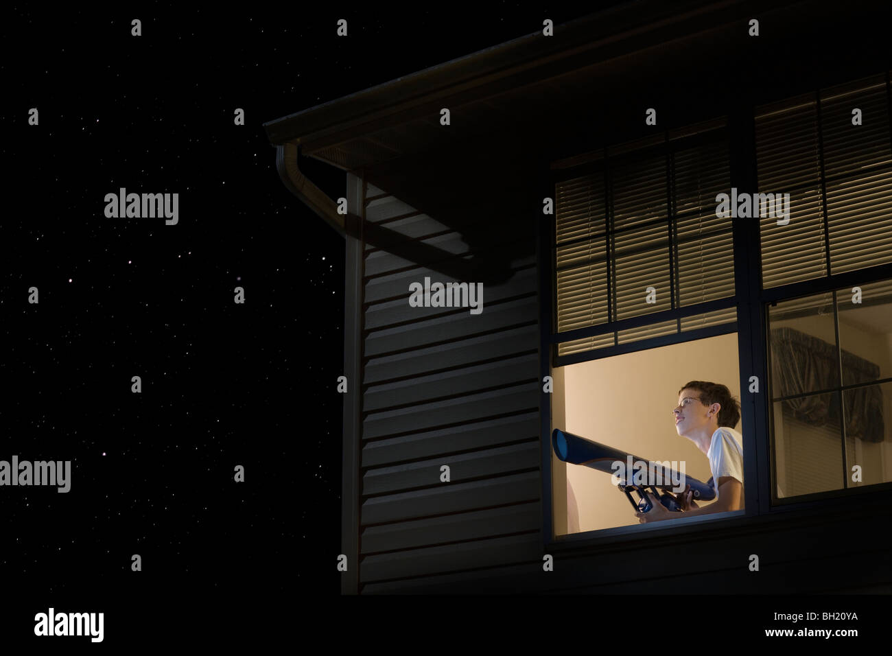 Open window at night - Stock Photo Teenage Boy Stands With Telescope At Open Window Looking At Night Sky