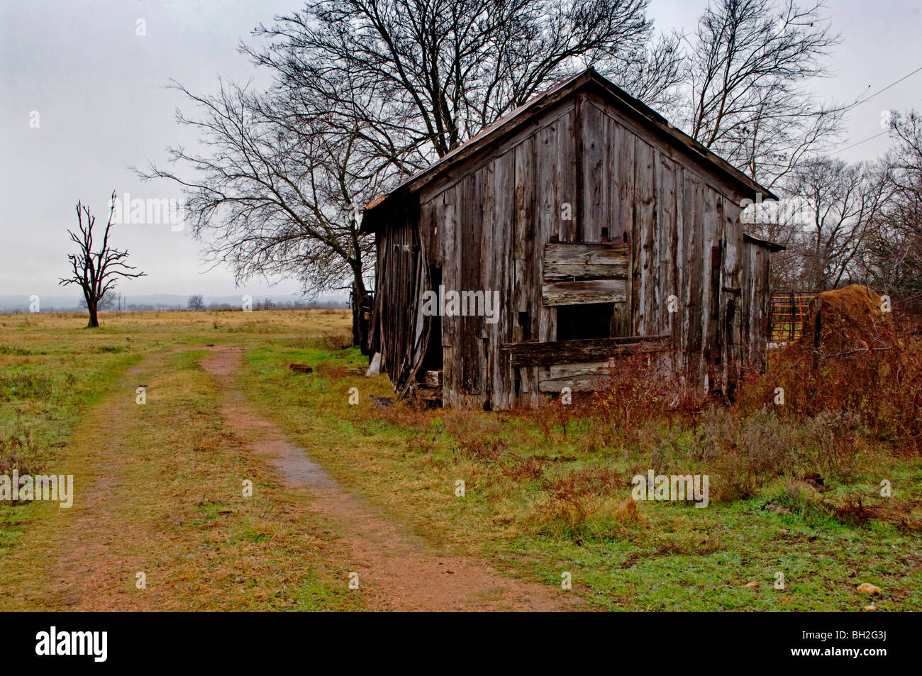 1920s era worn and weathered, rustic barns and commercial buildings from  yesteryear show the years in an American west farmtown