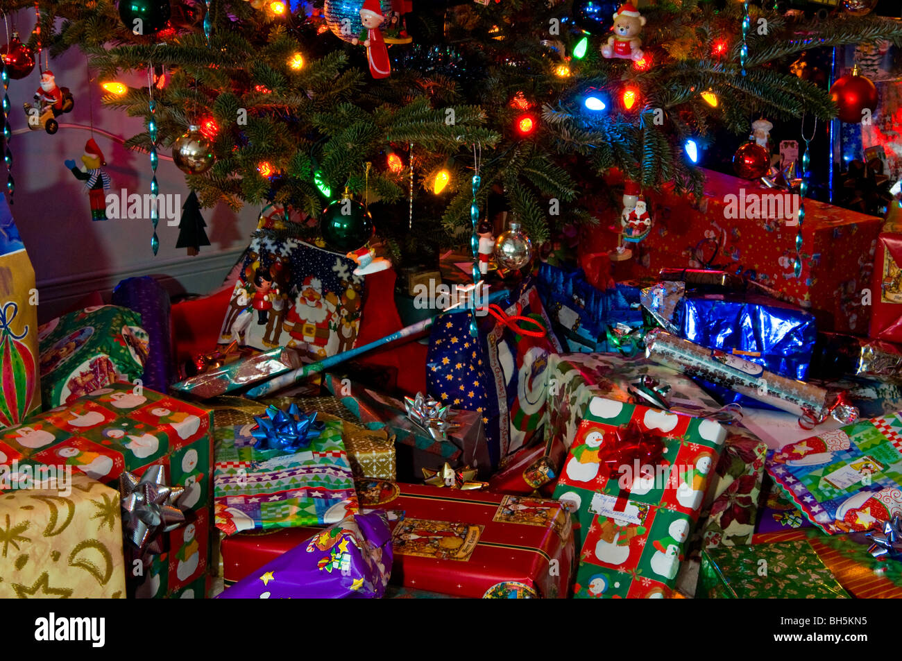 Christmas presents and gifts under a Christmas tree on Christmas ...