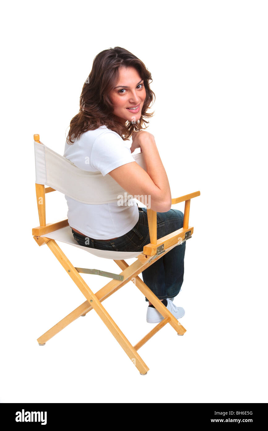 Back of director chairs - A Brunette Woman In Casual Clothing Sat On A Directors Chair Looking Back Over Her Shoulder