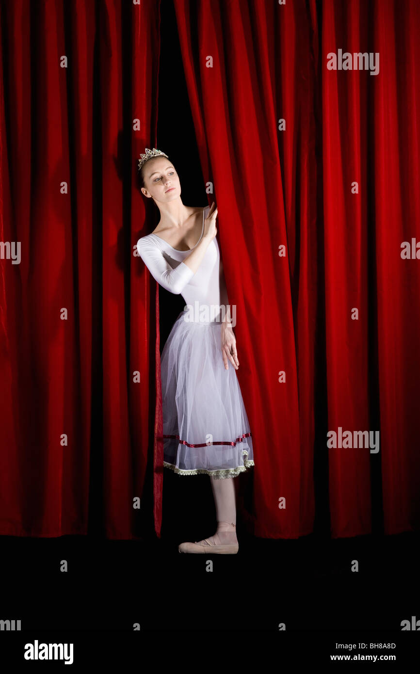 Stage curtains animation - Stage Curtains Hd A Ballet Dancer Peeking Through A Stage Curtain Front View Stock Image