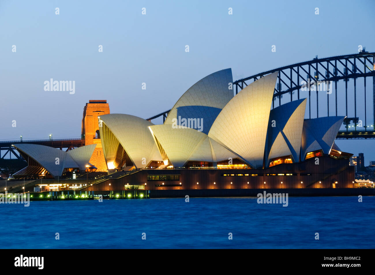 Sydney opera house and harbour bridge - Stock Photo Sydney Opera House And Sydney Harbour Bridge In The Background As Seen From Rom Mrs Macquarie S Point At Night