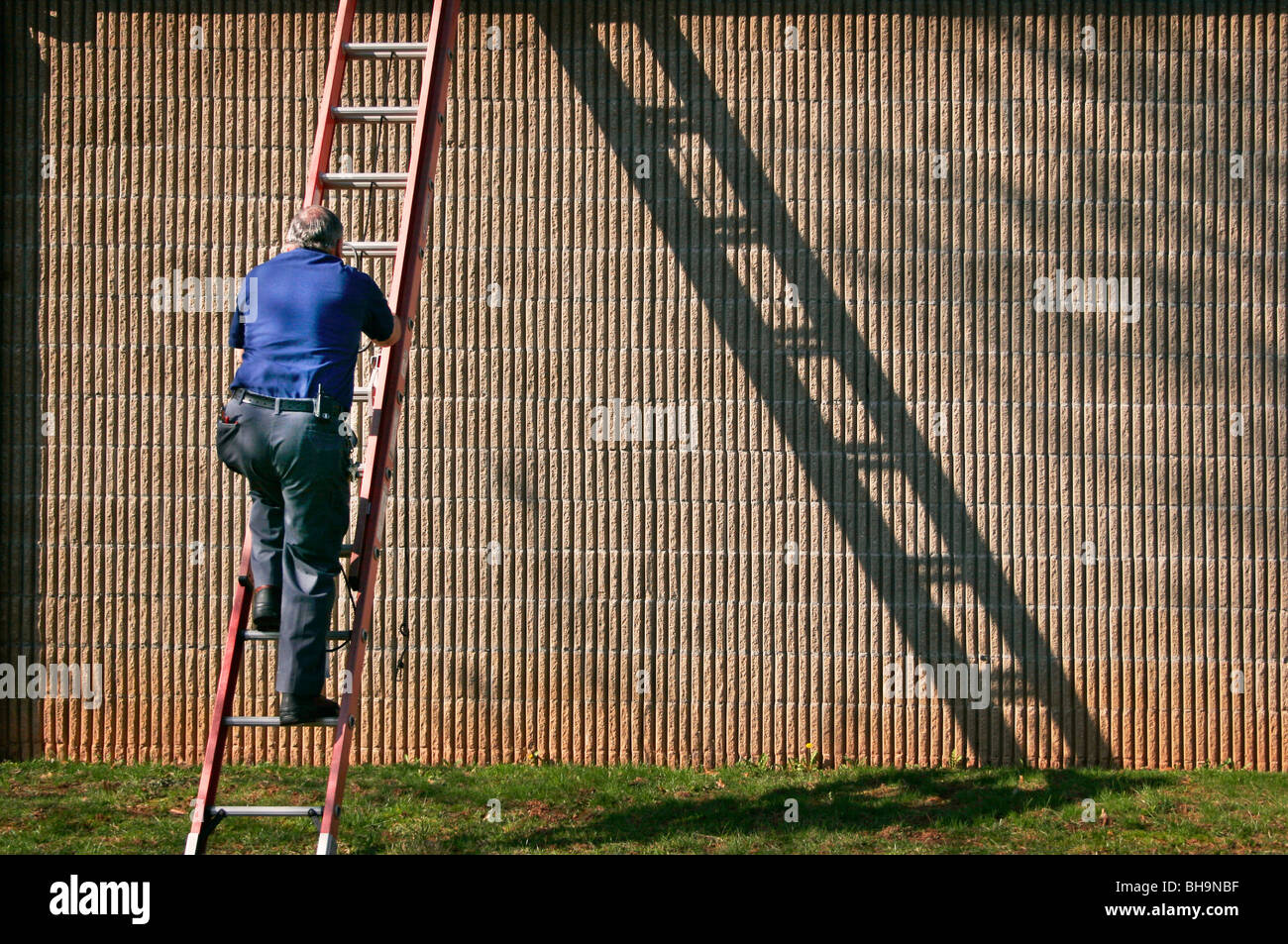 Man Climbing Ladder To Do Building Repair On Building Day