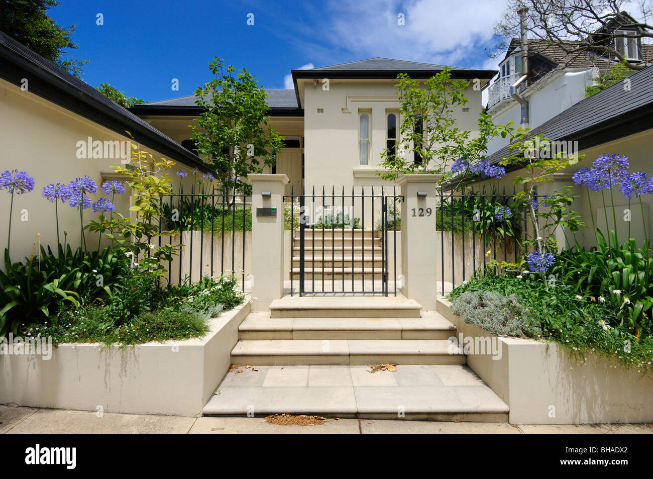 The Formal Front Courtyard Garden With Steps And Gate Of A
