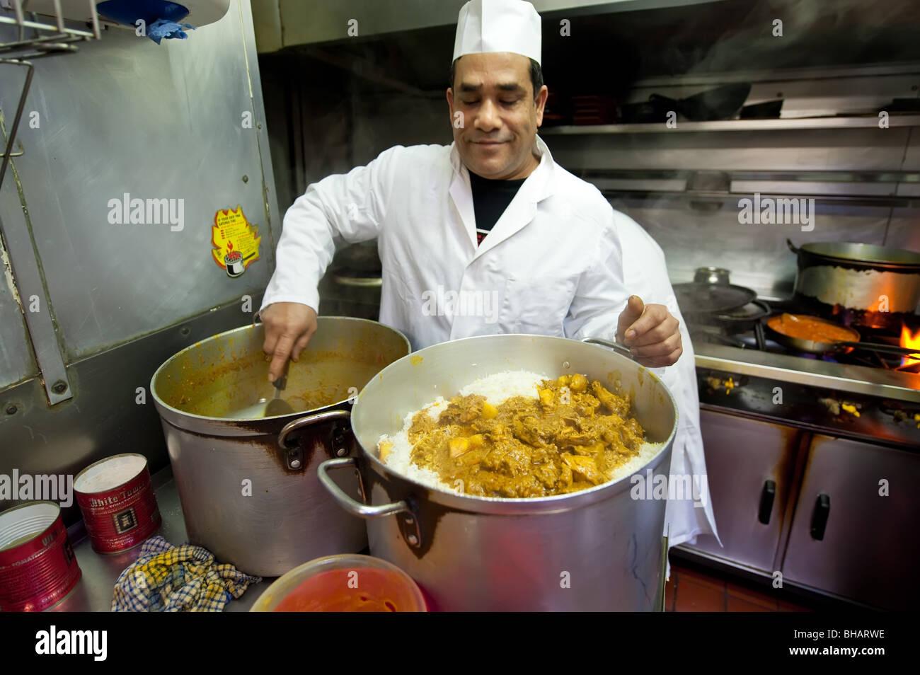 Restaurant Kitchen Chefs indian chef cooking in a restaurant kitchen stock photo, royalty